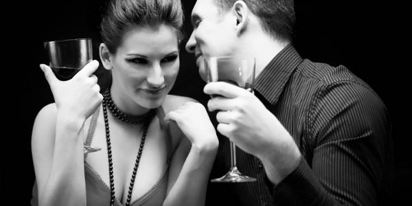 Young couple drinking wine and having fun
